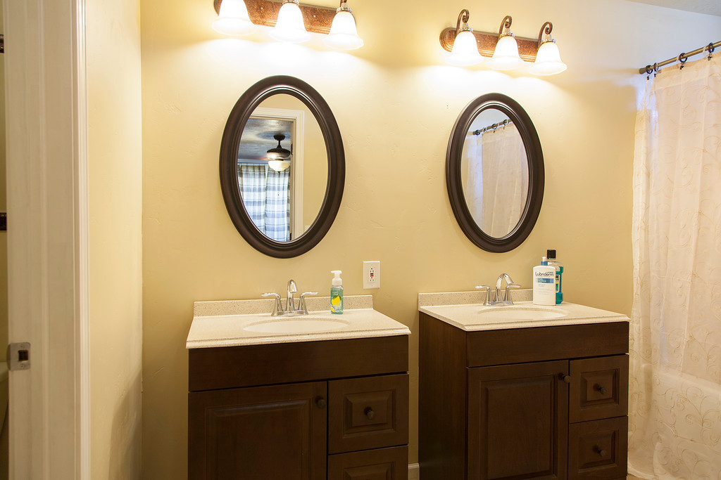 Master Bath w/ Duel Vanities, Private Toilet & shower/tub combo.
